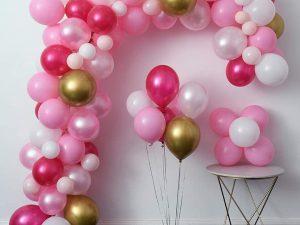 Pink balloons half arch